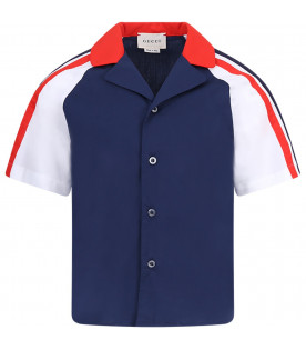 White and blue boy shirt with red and grreen logo