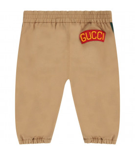 Beige babyboy pants with orange logo