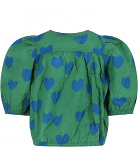 Green girl blouse with blue hearts